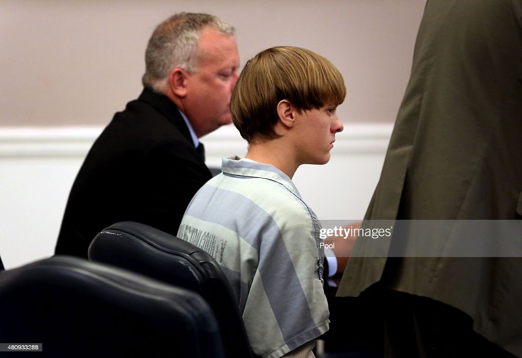Dylan Roof (C), the suspect in the mass shooting that left nine dead in a Charleston church last month, appears in court accompanied by assistant defensive attorney William Maguire July 18, 2015 in Charleston, South Carolina. The Associated Press, WCIV-TV and The Post and Courier of Charleston are challenging a judge's order issued last week that prohibits the release of public records in the June 17 shooting at Emanuel African Methodist Episcopal church.