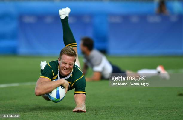 Dylan Sage of South Africa dives over for a try during the Men's Rugby Sevens Pool B match between South Africa and France on Day 4 of the Rio 2016...