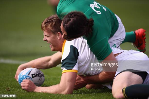 Dylan Sage of South Africa scores a try against Harry McNulty of Ireland during the quarterfinal match between South Africa and Ireland on Day 2 of...