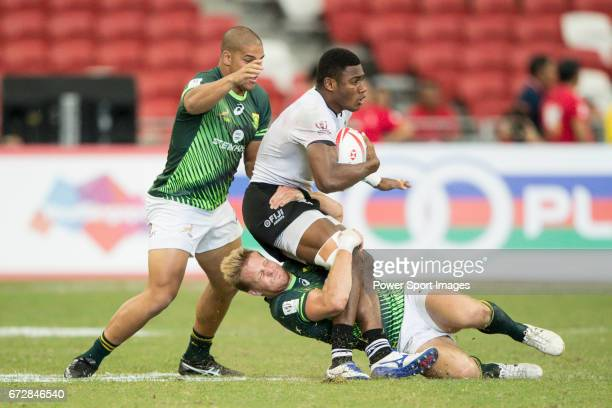 Dylan Sage of South Africa tries to tackle Setareki Bituniyata of Fiji during the match Fiji vs South Africa Day 2 of the HSBC Singapore Rugby Sevens...