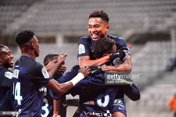 Dylan Saint Louis of Paris FC is mobbed after putting his side 10 ahead during the Ligue 2 match between Paris FC and Bourg en Bresse at Stade...