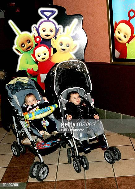 Dylan Seth Reiner 13monthsold and 15monthold Jackson Alexander Stern of Manhattan pose in front of a 'Teletubbies' cut out as they attend the...