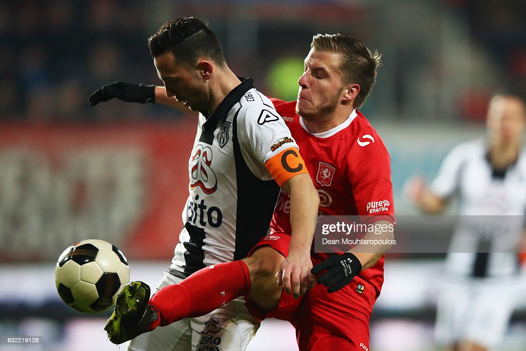 Dylan Seys of FC Twente battles for the ball with Thomas Bruns of Heracles Almelo during the Dutch Eredivisie match between FC Twente and Heracles Almelo held at De Grolsch Veste on January 20, 2017 in Enschede, Netherlands.