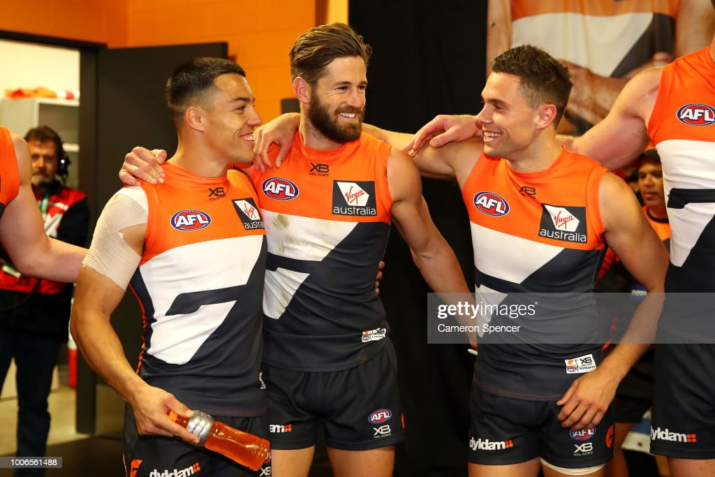Dylan Shiel, Callan Ward and Josh Kelly of the Giants celebrate winning the round 19 AFL match between the Greater Western Sydney Giants and the St Kilda Saints at Spotless Stadium on July 28, 2018 in Sydney, Australia.