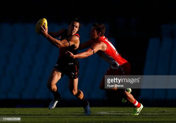 Dylan Shiel of the Bombers of the Bombers cfrtba Oliver Florent of the Swans during the round 2 AFL match between the Sydney Swans and the Essendon...