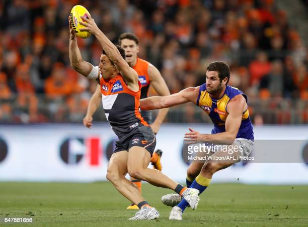 Dylan Shiel of the Giants and Jack Darling of the Eagles in action during the 2017 AFL First Semi Final match between the GWS Giants and the West...