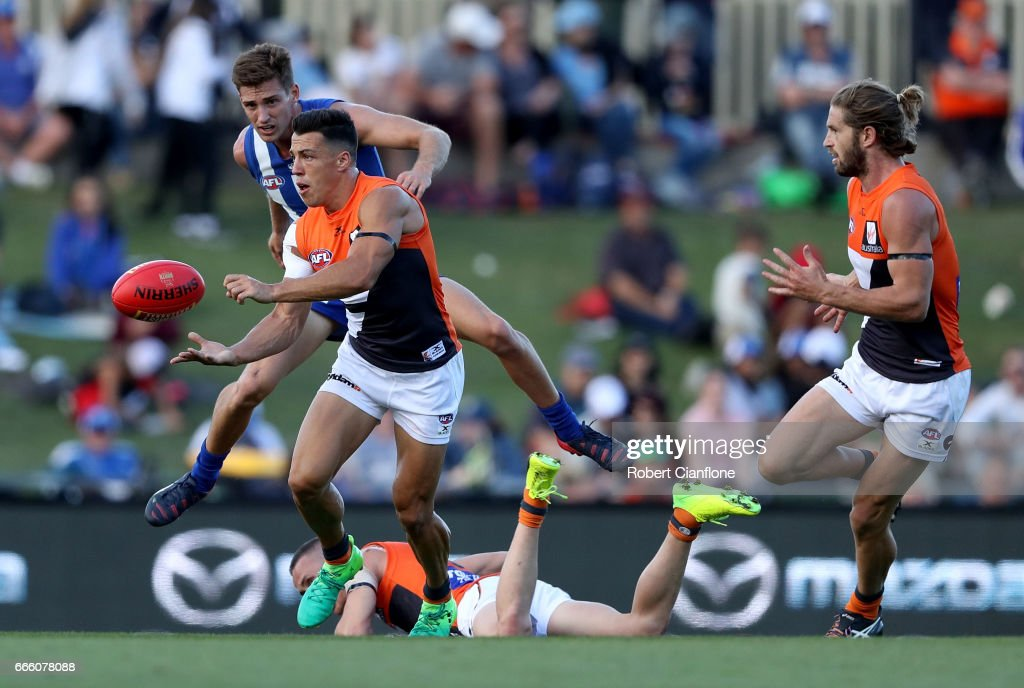 Dylan Shiel of the Giants handballs during the round three AFL match between the North Melbourne Kangaroos and the Greater Western Sydney Giants at Blundstone Arena on April 8, 2017 in Hobart, Australia.