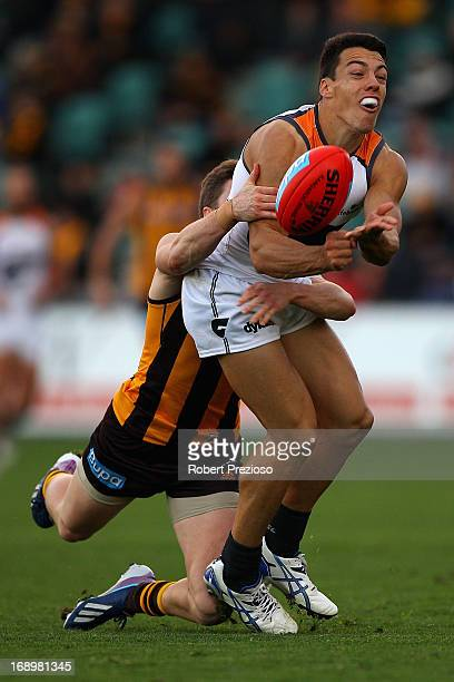Dylan Shiel of the Giants handballs under pressure during the round eight AFL match between the Hawthorn Hawks and the Greater Western Sydney Giants...
