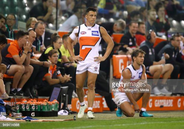 Dylan Shiel of the Giants is stuck on the interchange bench with the ball on the other side of the ground in the final few minutes of play during the...