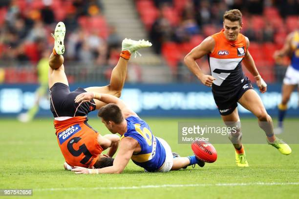 Dylan Shiel of the Giants is tackled by Elliot Yeo of the Eagles as Zac Langdon of the Giants watches on during the round eight AFL match between the...