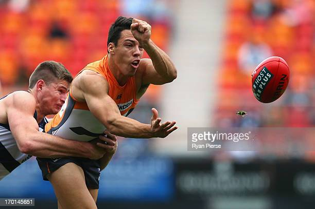 Dylan Shiel of the Giants is tackled by Nathan Vardy of the Cats during the round 11 AFL match between the Greater Western Sydney Giants and the...