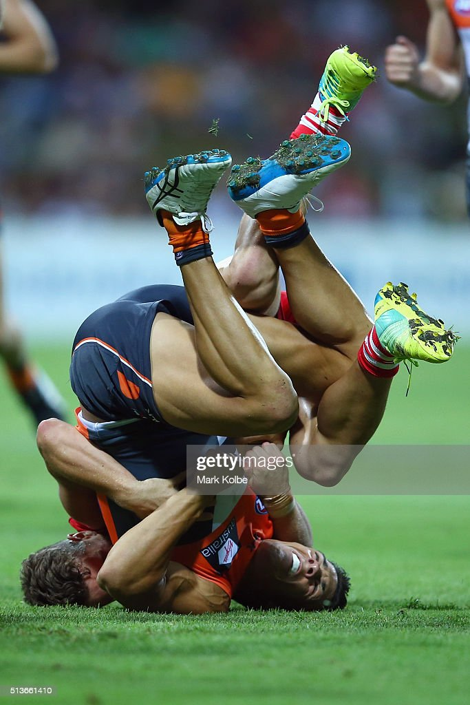 Dylan Shiel of the Giants is tackled by Tom Papley of the Swans during the 2016 AFL NAB Challenge match between the Sydney Swans and the Greater Western Sydney Giants at Drummoyne Oval on March 4, 2016 in Sydney, Australia.