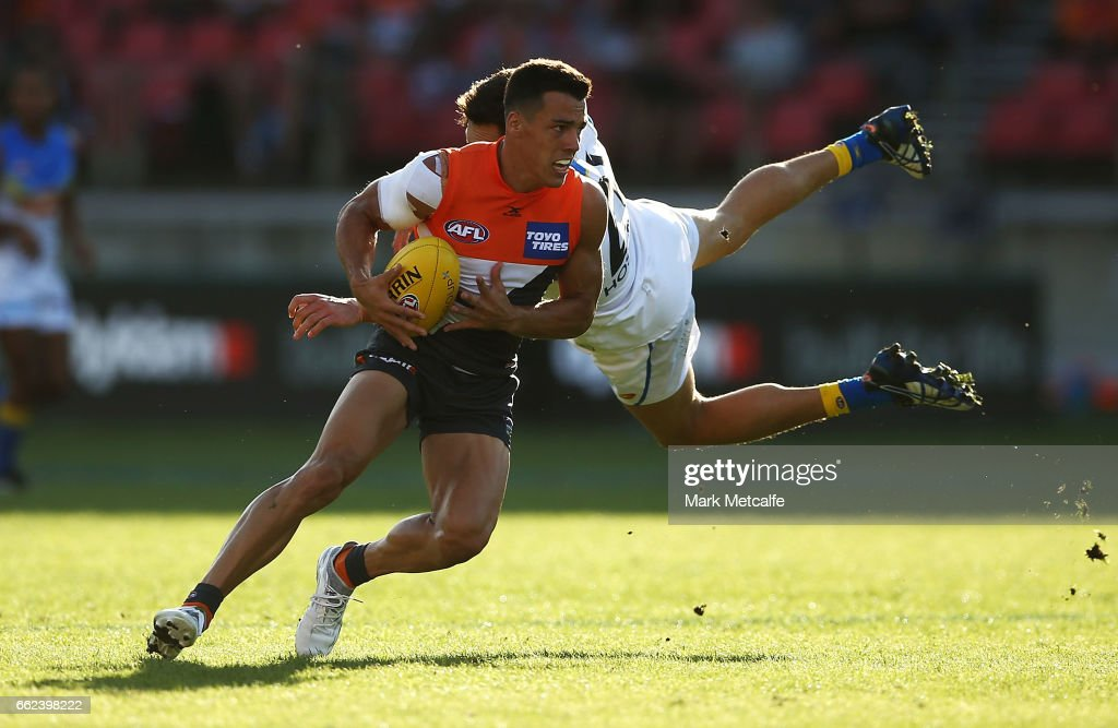 Dylan Shiel of the Giants takes on Jeremy Taylor of the Suns during the round two AFL match between the Greater Western Sydney Giants and the Gold Coast Suns at Spotless Stadium on April 1, 2017 in Sydney, Australia.