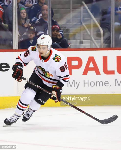 Dylan Sikura of the Chicago Blackhawks follows the play up the ice during second period action against the Winnipeg Jets at the Bell MTS Place on...