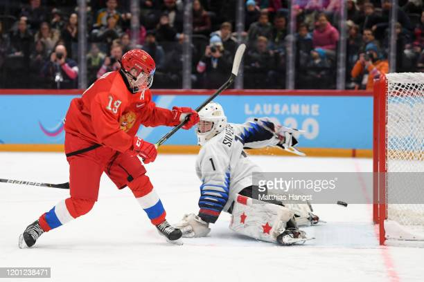 Dylan Silverstein of USA and Matvei Michkov of Russia battle for the puck during the Men's 6Team Ice Hockey Tournament Finals Gold Medal Game between...
