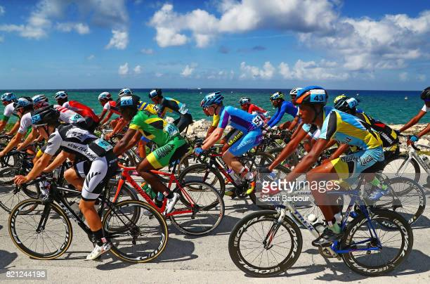 Dylan Simpson of New Zealand Stephen Dent of Scotland and Kluivert Mitchel of Saint Lucia compete in the Boys«s Road Race Cycling Final on day 6 of...