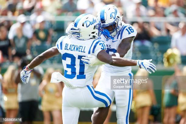 Dylan Singleton of the Duke Blue Devils celebrates after recovering a fumble with teammate Josh Blackwell against the Baylor Bears during the first...