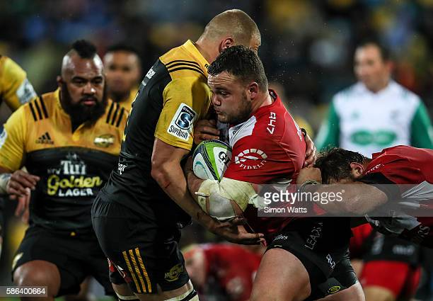Dylan Smith of the Lions is tackled during the 2016 Super Rugby Final match between the Hurricanes and the Lions at Westpac Stadium on August 6 2016...