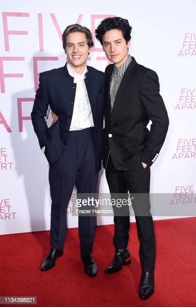 Dylan Spouse and Cole Sprouse attend the Premiere Of Lionsgate's Five Feet Apart at Fox Bruin Theatre on March 07 2019 in Los Angeles California