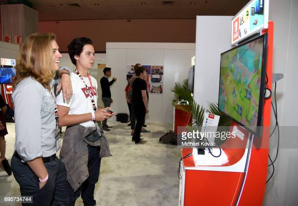 Dylan Sprouse and Cole Sprouse play Mario + Rabbids Kingdom Battle the Nintendo booth at the 2017 E3 Gaming Convention at Los Angeles Convention...