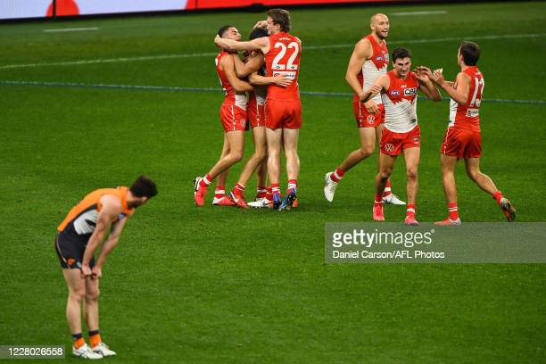 Dylan Stephens of the Swans celebrates a goal during the 2020 AFL Round 12 match between the Sydney Swans and the GWS Giants at Optus Stadium on...