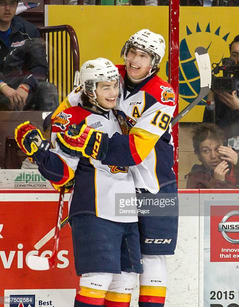 Dylan Strome and Alex DeBrincat of the Erie Otters celebrate a goal against the Windsor Spitfires on March 19, 2015 at the WFCU Centre in Windsor,...