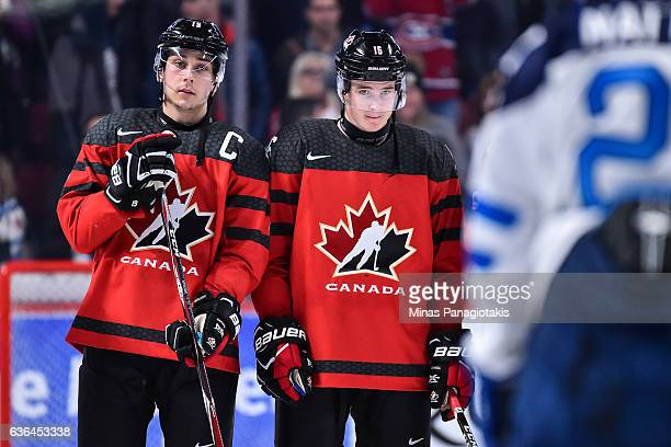 Dylan Strome and teammate Taylor Raddysh of Team Canada look on during the IIHF post game exhibition ceremony against Team Finland at the Bell Centre...