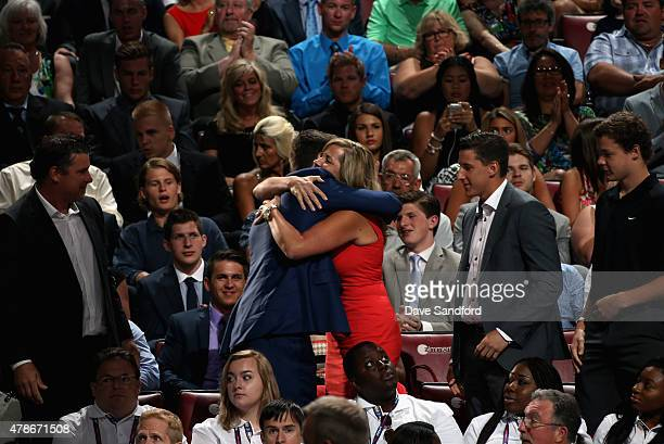 Dylan Strome is congratulated by his family after he was selected third overall by the the Arizona Coyotes during Round One of the 2015 NHL Draft at...