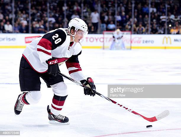 Dylan Strome of the Arizona Coyotes controls the puck during a preseason game against the Los Angeles Kings at Staples Center on September 22 2015 in...