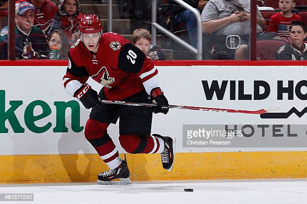 Dylan Strome of the Arizona Coyotes skates with the puck during the NHL preseason game against the San Jose Sharks at Gila River Arena on October 2...