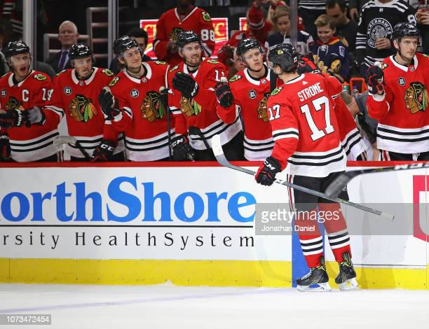 Dylan Strome of the Chicago Blackhawks is congratulated by teammates after scoring his first goal as a member of the Blackhawks against the Vegas...