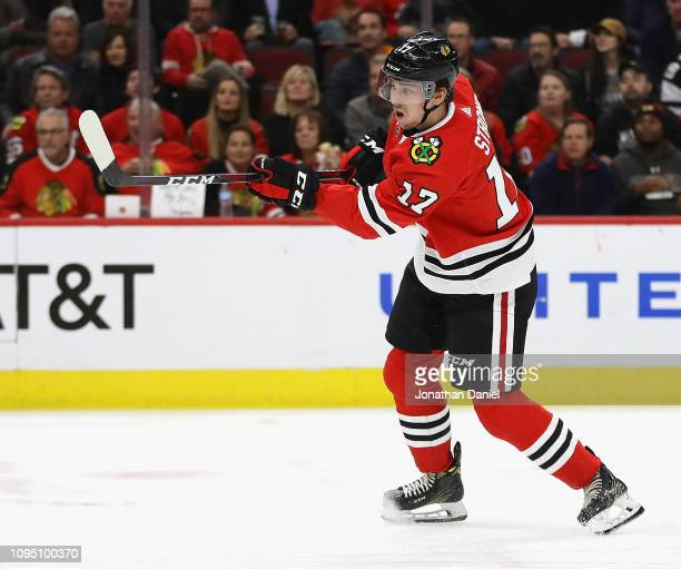 Dylan Strome of the Chicago Blackhawks shoots against the Nashville Predators at the United Center on January 09 2019 in Chicago Illinois The...