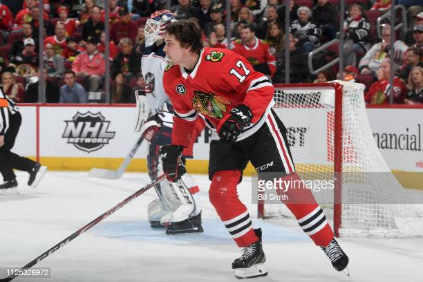 Dylan Strome of the Chicago Blackhawks skates after losing his helmet in the third period against the Columbus Blue Jackets at the United Center on...