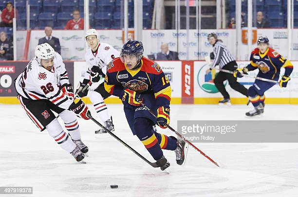 Dylan Strome of the Erie Otters battles for the puck with Josh HoSang of the Niagara IceDogs during an OHL game at the Meridian Centre on November 19...