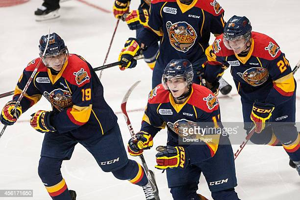 Dylan Strome Taylor Raddysh and Darren Raddysh of the Erie Otters celebrate a goal against the Windsor Spitfires on September 26 2014 at the WFCU...
