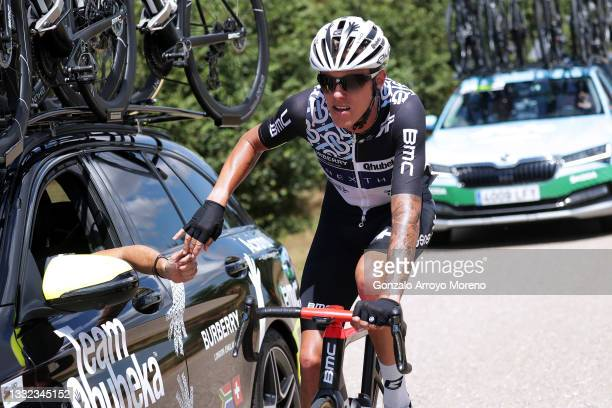 Dylan Sunderland of Australia and Team Qhubeka Nexthash grabs food from Team Car during the 43rd Vuelta a Burgos 2021, Stage 2 a 175km stage from...