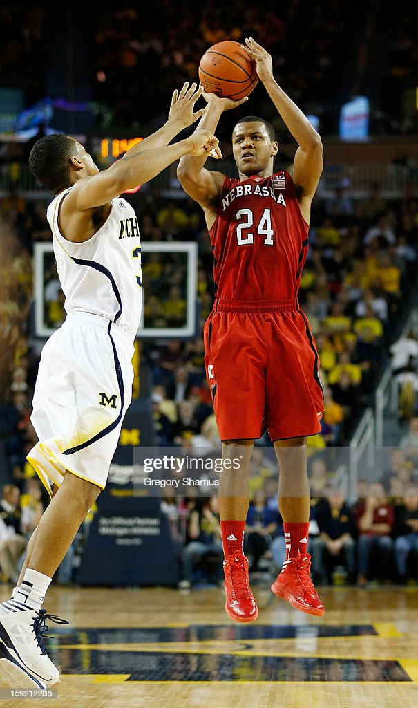 Dylan Talley #24 of the Nebraska Cornhuskers takes a second half three point shot over Trey Burke #3 of the Michigan Wolverines at Crisler Center on January 9, 2013 in Ann Arbor, Michigan. Michigan won the game 62-47.