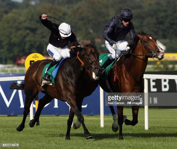 Dylan Thomas and jockey Kieren Fallon wins the Baileys Irish Champion stakes from Ouija Board and jockey Jamie Spencer at Leopardstown racecourse...