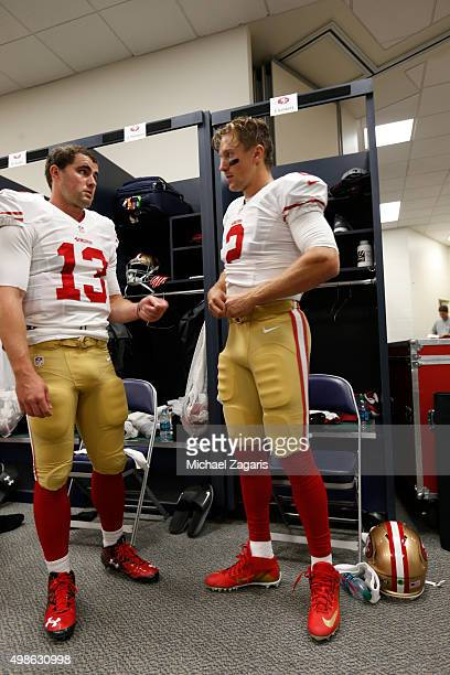 Dylan Thompson and Blaine Gabbert of the San Francisco 49ers talk in the locker room prior to the game against the Seattle Seahawks at CenturyLink...