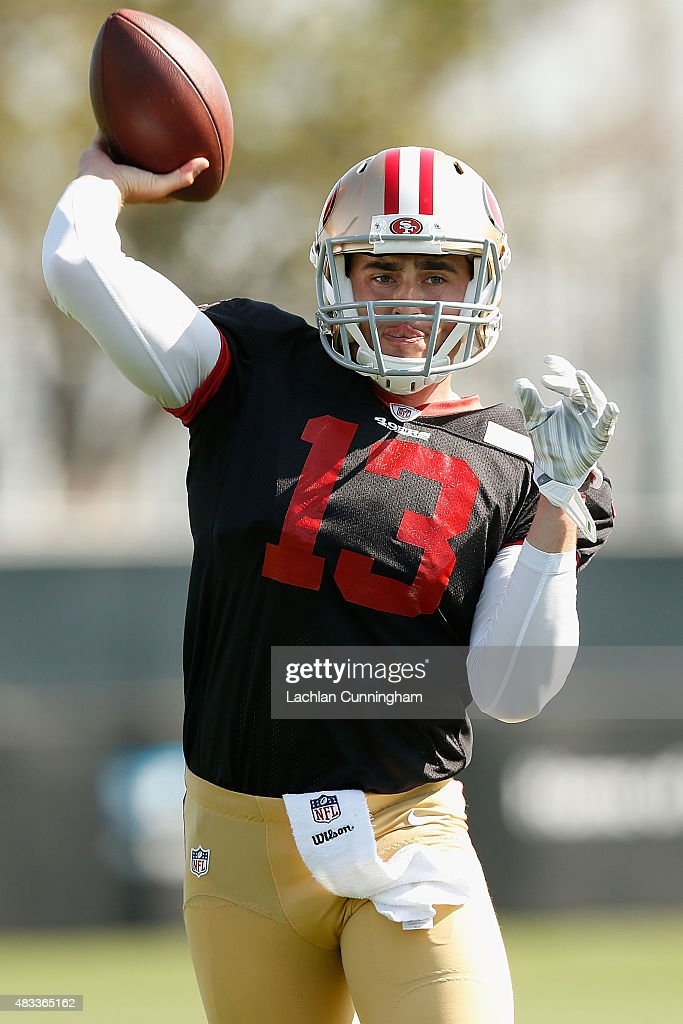 Dylan Thompson #13 of the San Francisco 49ers passes during drills at a practice session at Levi's Stadium on August 7, 2015 in Santa Clara, California.