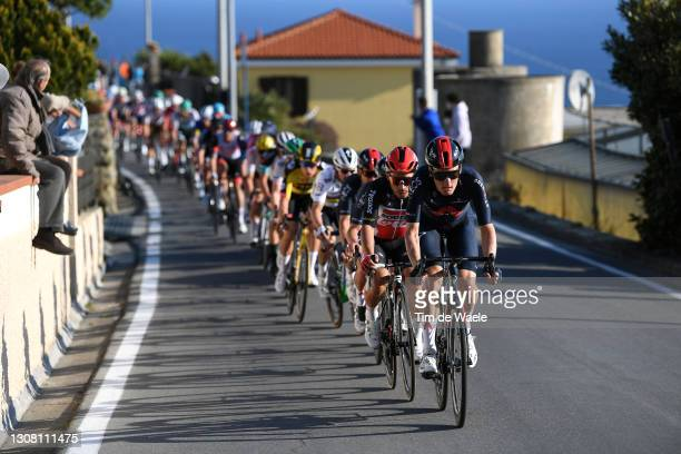 Dylan Van Baarle of Netherlands and Team INEOS Grenadiers & Caleb Ewan of Australia and Team Lotto Soudal during the 112th Milano-Sanremo 2021 a...