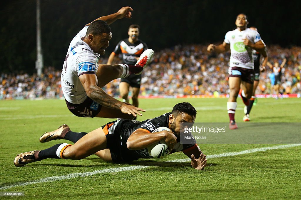 Dylan Walker of the Eagles attempts to prevent David Nofoaluma of the Tigers from scoring a try during the round two NRL match between the Wests Tigers and the Manly Sea Eagles at Leichhardt Oval on March 14, 2016 in Sydney, Australia.