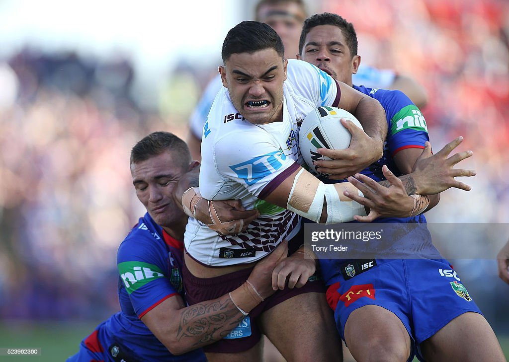 Dylan Walker of the Manly Sea Eagles is tackled by the Knights defence during the round eight NRL match between the Newcastle Knights and the Manly Sea Eagles at Hunter Stadium on April 25, 2016 in Newcastle, Australia.