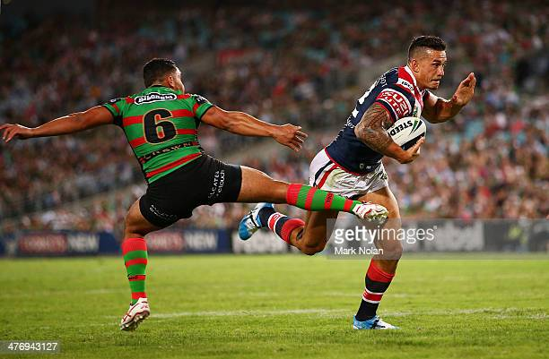 Dylan Walker of the Rabbioths attempts to tackle Sonny Bill Williams of the Roosters during the round one NRL match between the South Sydney...