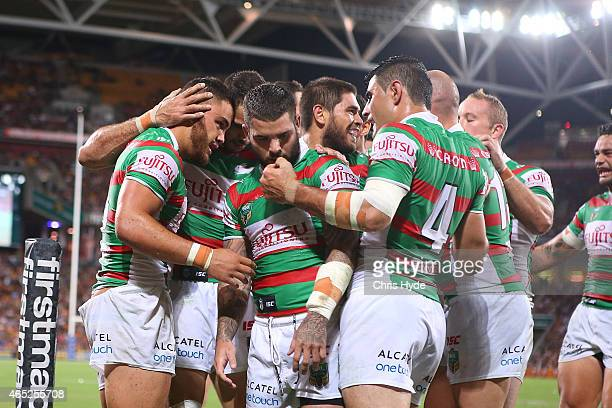 Dylan Walker of the Rabbitohs celebrates a try during the round one NRL match between the Brisbane Broncos and the South Sydney Rabbitohs at Suncorp...