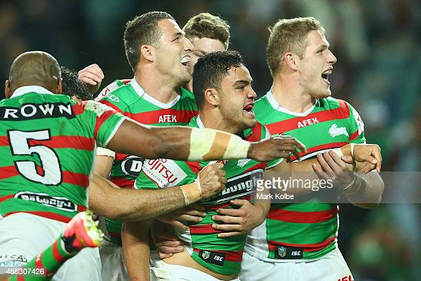 Dylan Walker of the Rabbitohs celebrates with his team mates after scoring a try during the NRL 2nd Qualifying Final match between the Manly Sea...