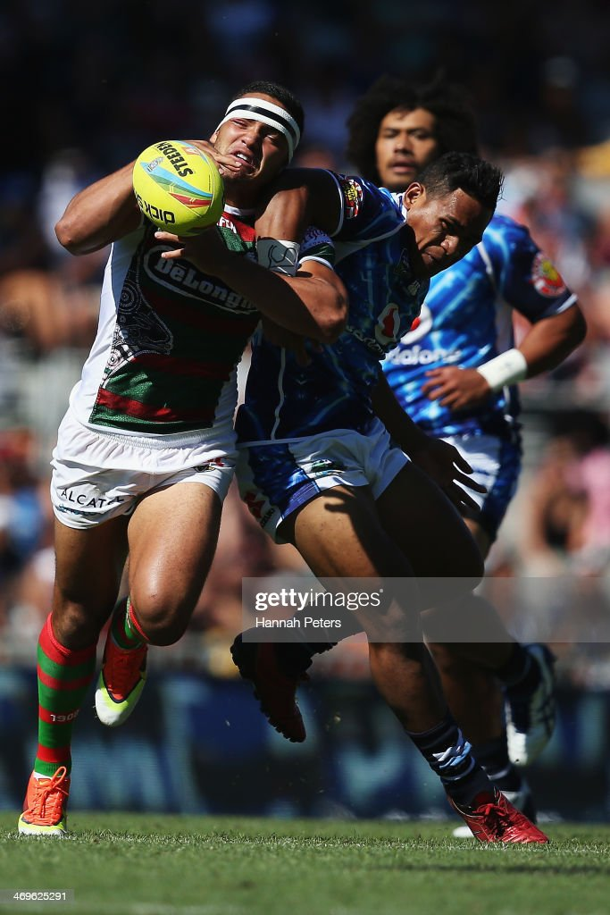 Dylan Walker of the Rabbitohs competes with Solomone Kata of the Warriors during the quarter final match between the South Sydney Rabbitohs and the New zealand Warriors in the Auckland NRL Nines at Eden Park on February 16, 2014 in Auckland, New Zealand.