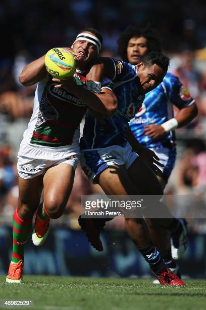 Dylan Walker of the Rabbitohs competes with Solomone Kata of the Warriors during the quarter final match between the South Sydney Rabbitohs and the...
