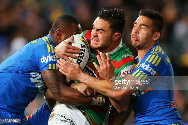 Dylan Walker of the Rabbitohs is tackled by Semi Radradra and Corey Norman of the Eels during the round 19 NRL match between the Parramatta Eels and...