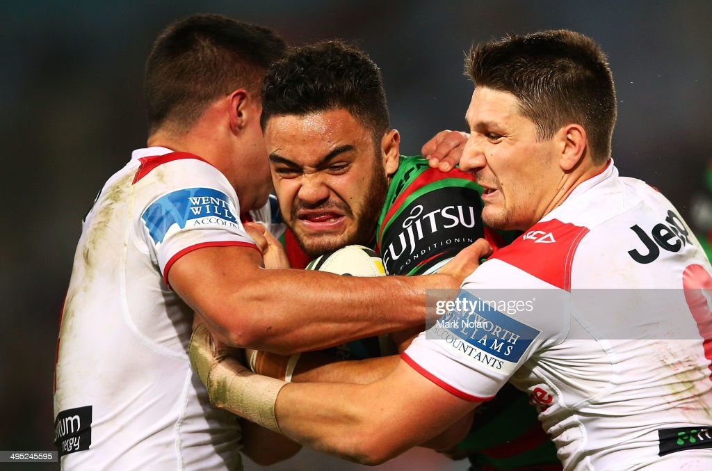 Dylan Walker of the Rabbitohs is tackled during the round 12 NRL match between the South Sydney Rabbitohs and the St George Illawarra Dragons at ANZ Stadium on June 2, 2014 in Sydney, Australia.